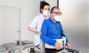 caregiver assisting a patient with ALS